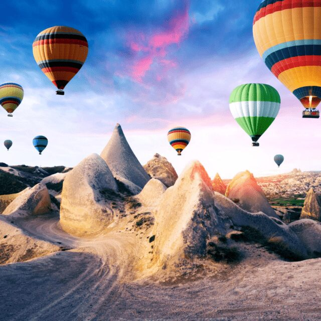 Best Turkey Holiday Destinations | colourful Hot air ballon over fairy chinmeys in Cappadocia