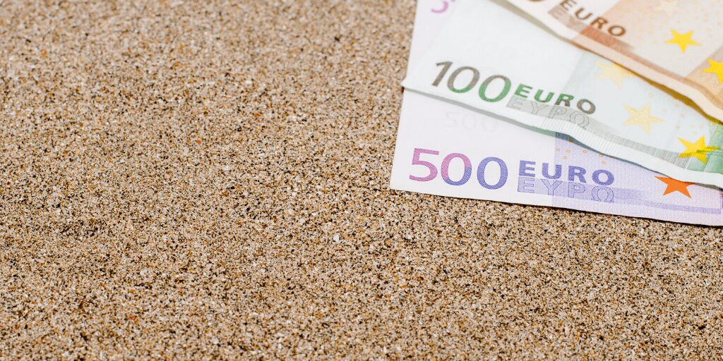 John Lewis Travel Money  Euro Cash on pebble in beach