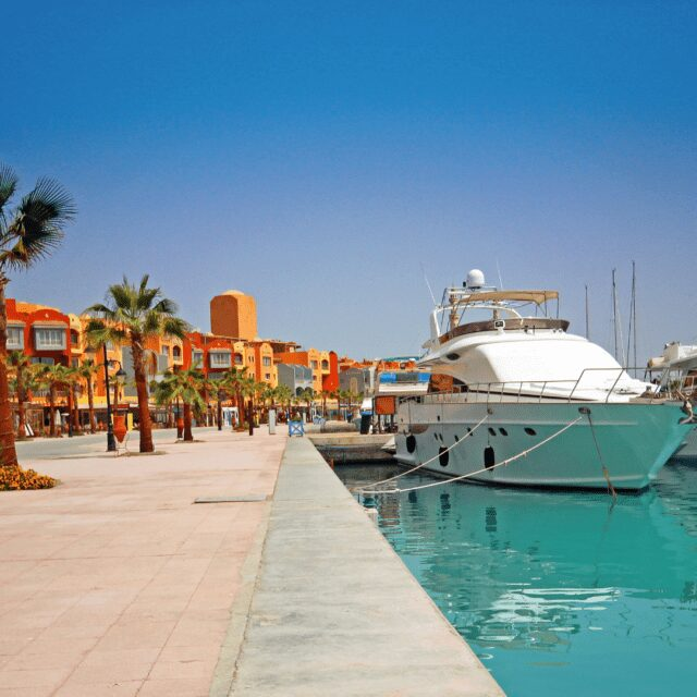 Colourful buildings and white ship for all-inclusive holidays Hurghada