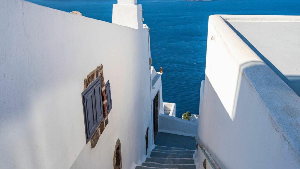 Best Santorini Pools with Infinty Pools 13 Weeks Travel narrow steps and alleys in stunning Santorini views